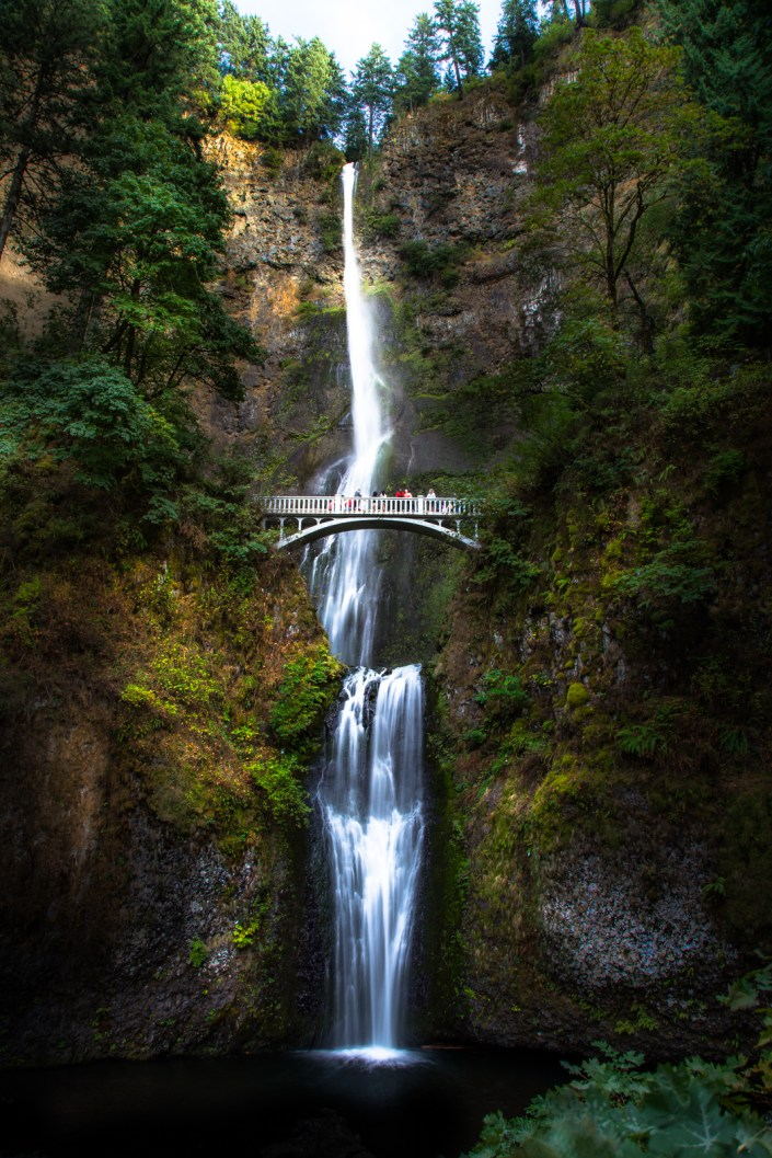 Multnomah falls cascades into two pools and under the iconic bridge