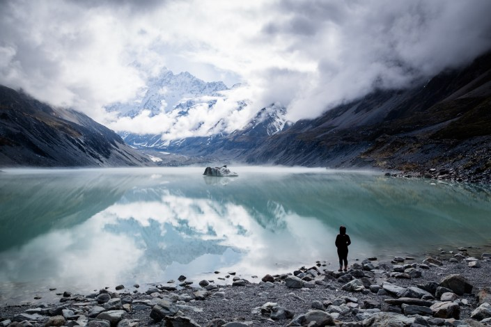 still waters reflect the view of mount cook a snow capped mountain
