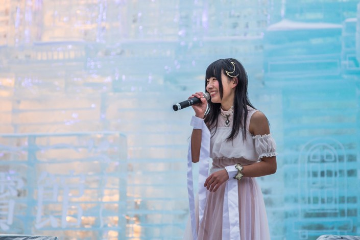 a woman performer sings onstage at ice festival in sapporo