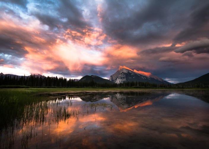 from vermillion lakes the sun illuminates the ridge of mt rundle a dramatic mountain int he canadian rockies