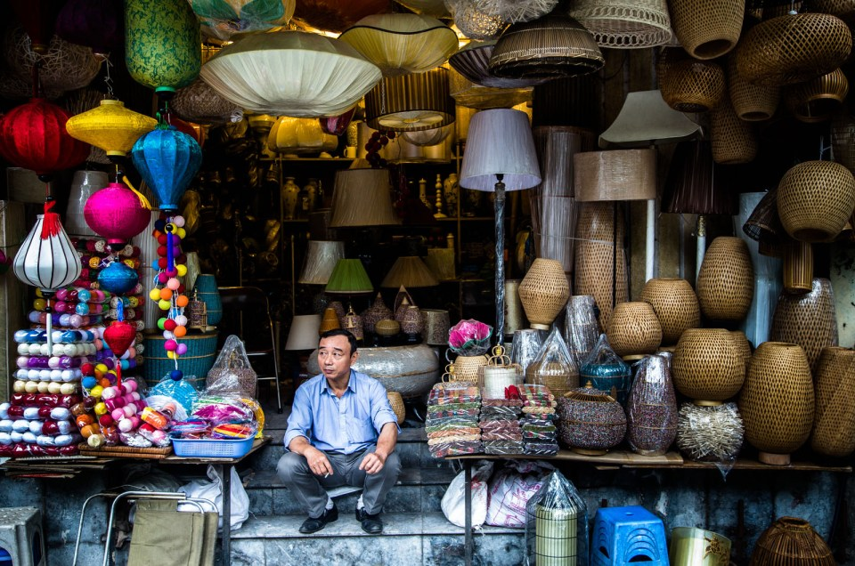Street photography in hanoi veitnam. a man sits in his Lantern shop