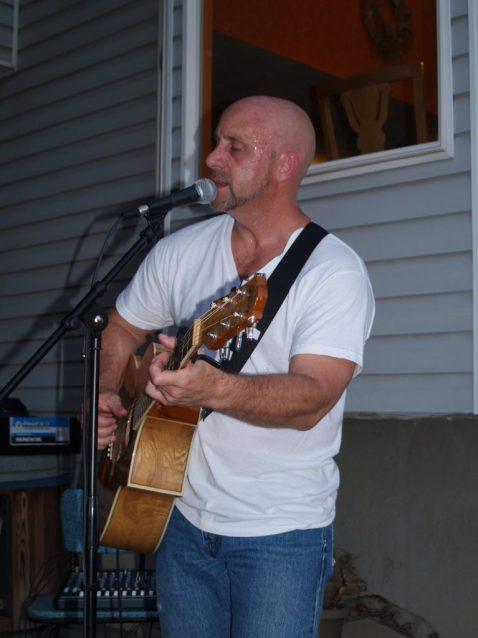 Image of Matthew Moran performing at a house concert in Utah