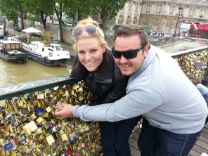 """Clipping our """"love lock"""" on to the Pont des Arts in Paris."""