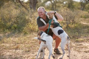 Richard Sowry with Jetta and Kombi, two Foxhounds that are being trained to track poachers in Kruger National Park. PICTURE: Ravi Gajjar