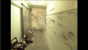 Corridor leading to the utility room. Black marks are probably fingerprint powder. The door on the left goes to the BNZ stairwell
