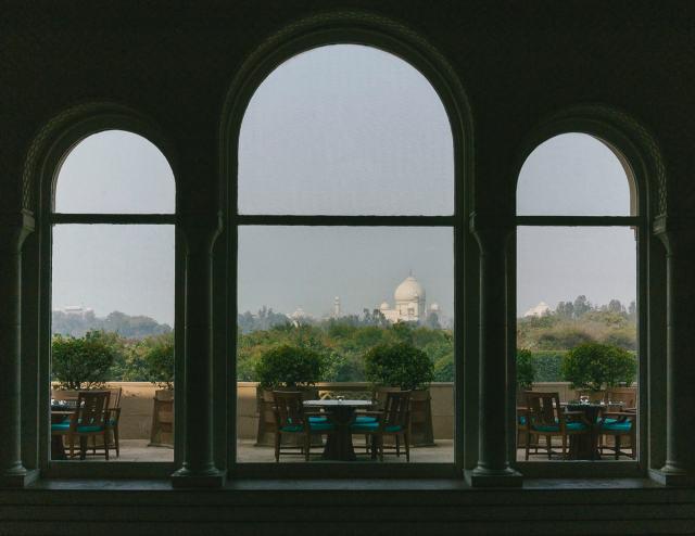 The Taj Mahal Through A Window In Agra