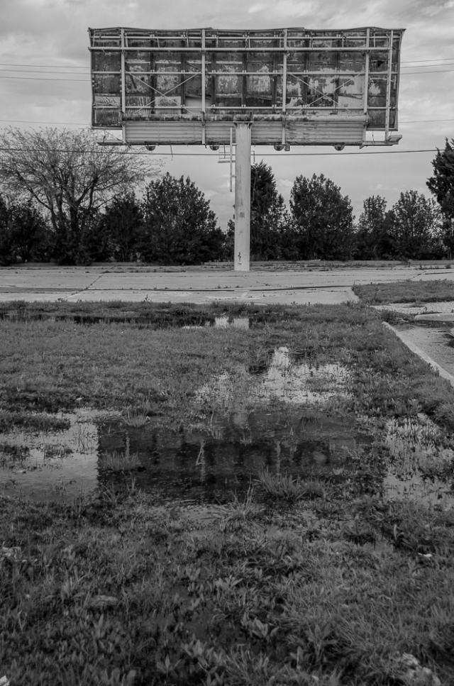 A rusty billboard in Arlington, Texas