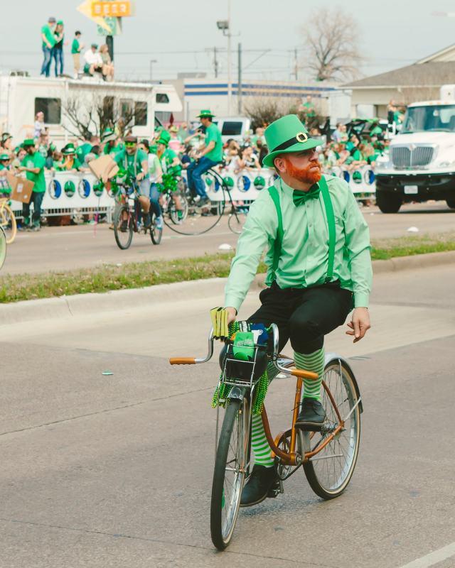 Aa leprechaun riding a bike in the parade