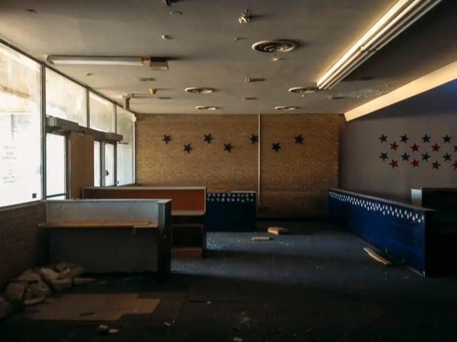 The main entrance now dirty with broken glass on the floor, Abandoned Dance Studio in Lake Highlands, Dallas Urban Exploration