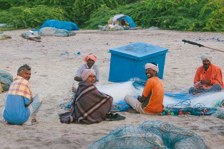 Fisherman preparing their nets on Nagapattinam Beach