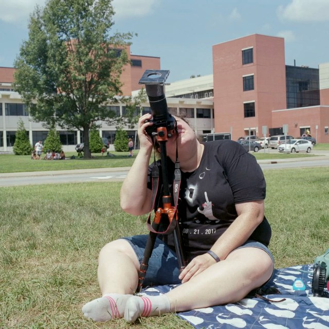 An analog portrait of a woman watching the event at SIU in Carbondale, Illinois