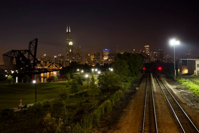 The skyline and railroad at night
