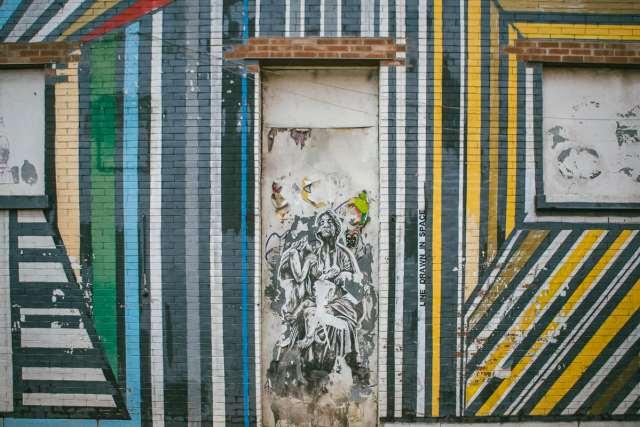 Graffiti and art work on a wall