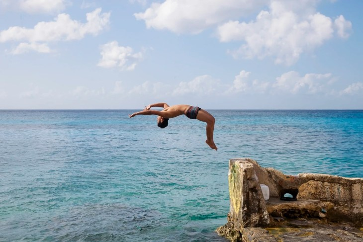 A guy doing a back flip in Cozumel