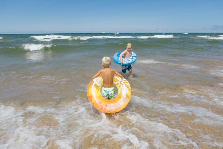 Boys playing in Lake Michigan at Holland Beach
