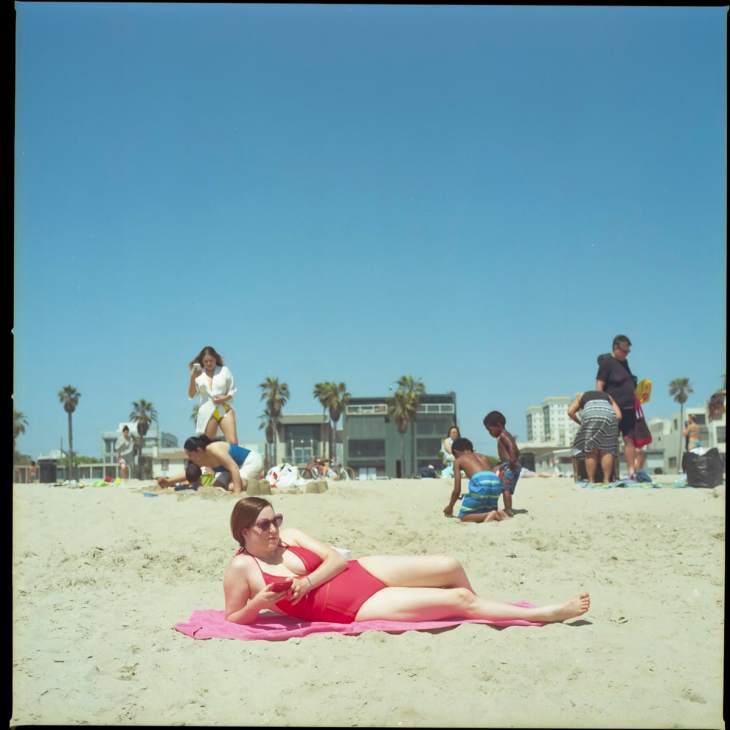 A woman relaxing at Venice Beach