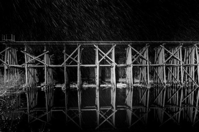 Hamilton Railroad Trestle Bridge at night in the snow