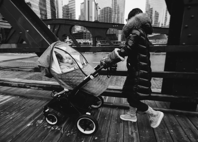 A mother pushing her baby in downtown Chicago