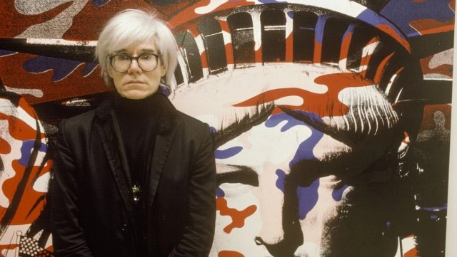 Andy Warhol paints the Statue of Liberty in Paris, France in 1986. Photograph: Francois Lochon/Gamma-Rapho via Getty