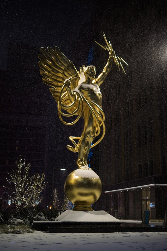 Spirit of Communication Statue by Evelyn Beatrice Longman in a snowstorm