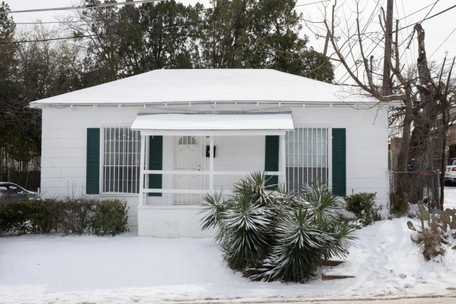 A house covered with snow