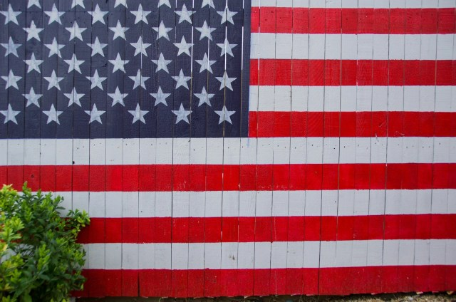 A fence with the American Flag painted on it