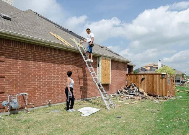 A couple repairing their home