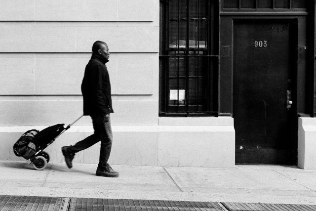 Man walking on the sidewalk in NYC