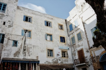 old white walls with blue shutters