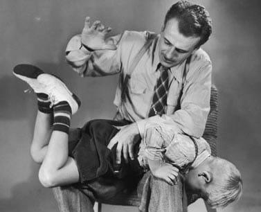 50s dad spanking a child
