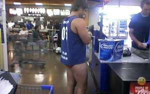 guy-with-no-pants-buying-beer-in-walmart