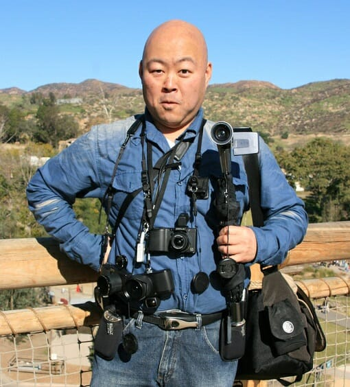 Japanese tourist with many cameras