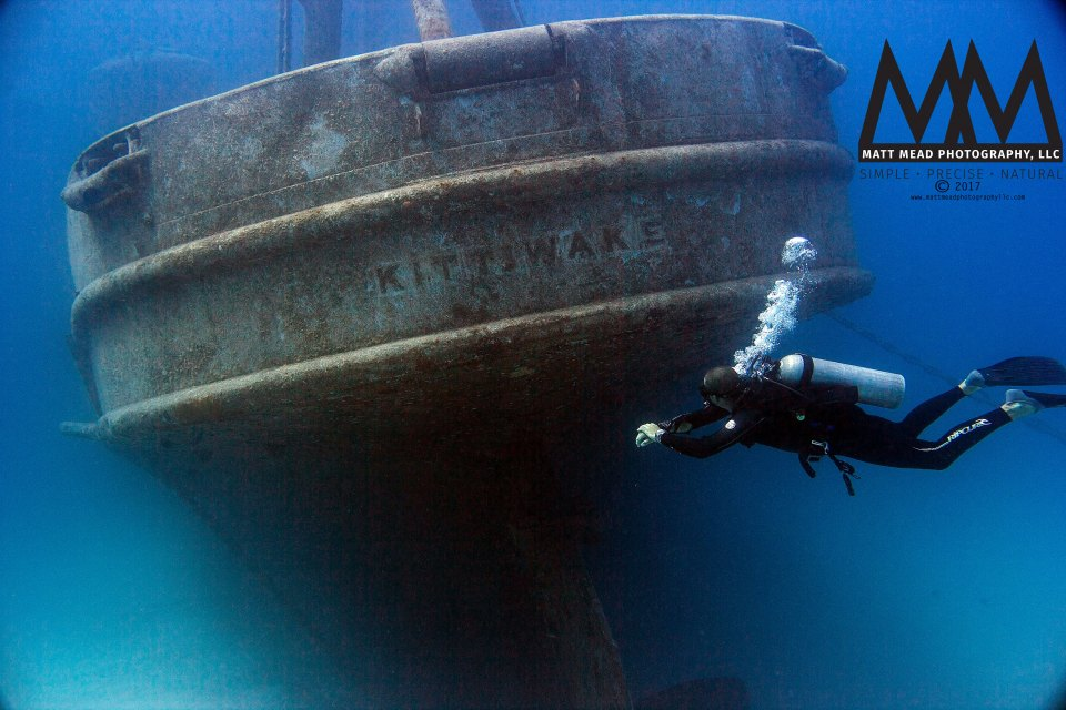 SCUBA diver and Kittiwake shipwreck in Grand Cayman