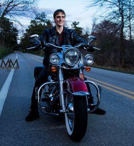 senior portrait smiles on motorcycle photo
