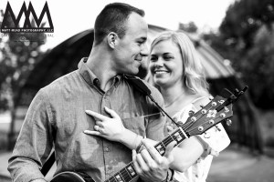 erie pa engagement man holding guitar photo
