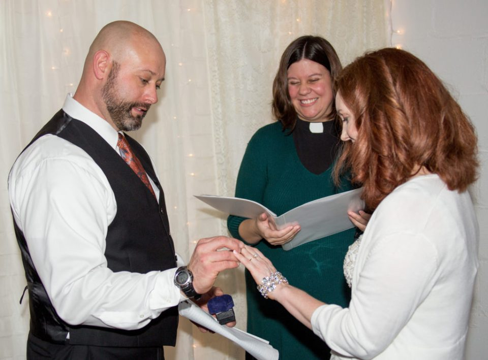 bride, groom and officiant during exchange of rings at DIY wedding in Erie, PA
