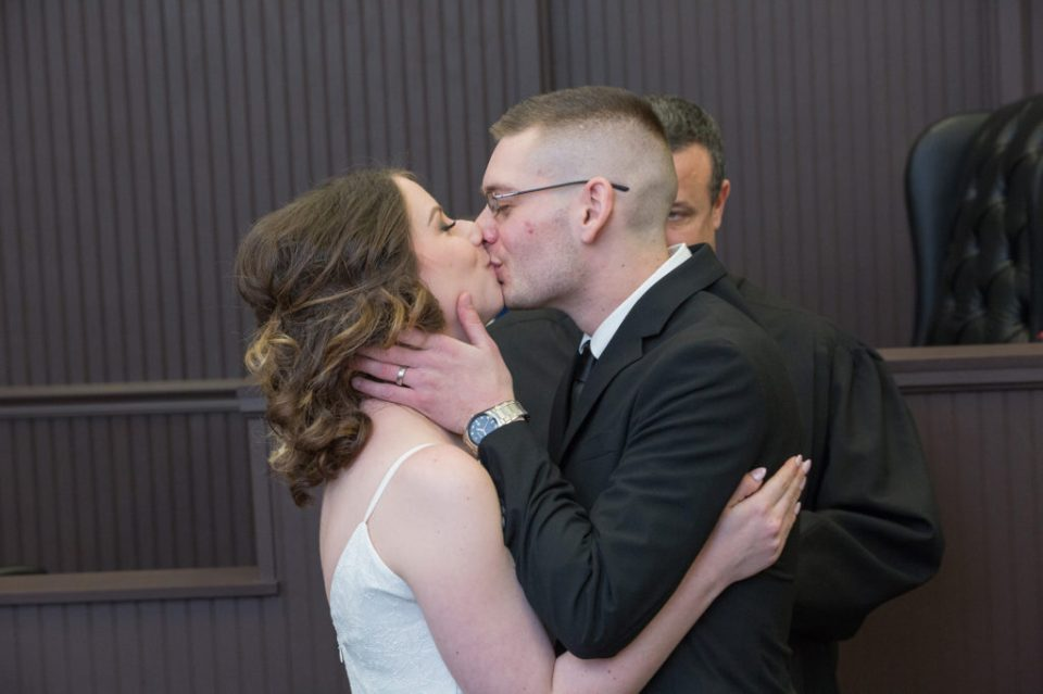 bride and groom's forst kiss as married couple in Erie, PA
