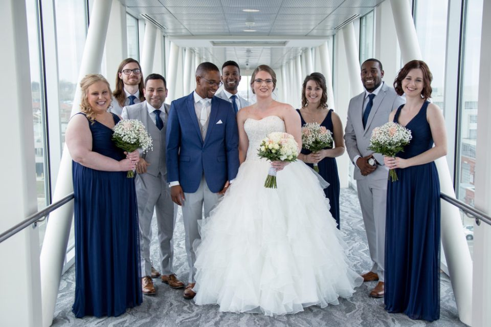 bride, groom and wedding party on skybridge for wedding at Sheraton Bayfront Hotel in Erie, PA