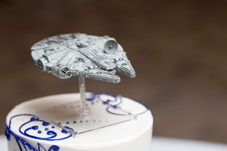 MIllenium Falcon cake topper at Star Wars themed wedding