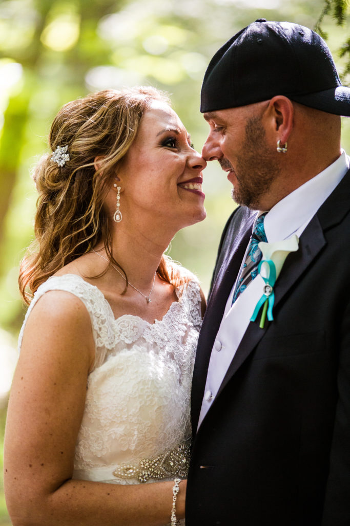 bride and groom smiling at each other in Erie PA backyard wedding