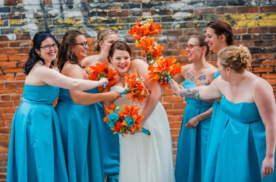 bride and her bridesmaid at Brewerie wedding in downtown Erie PA