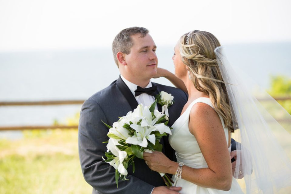 Erie PA bride and groom look lovingly at each other during wedding portraits at Lawrence Park Golf Club