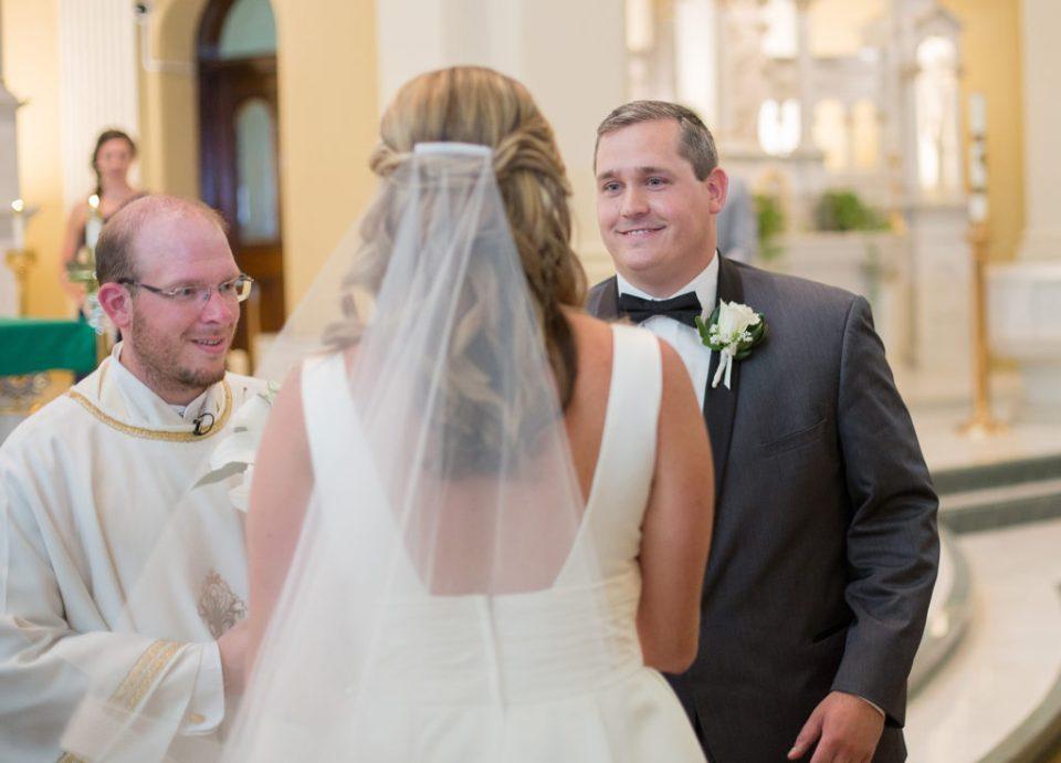 groom smiles at bride during Saint Patrick's wedding