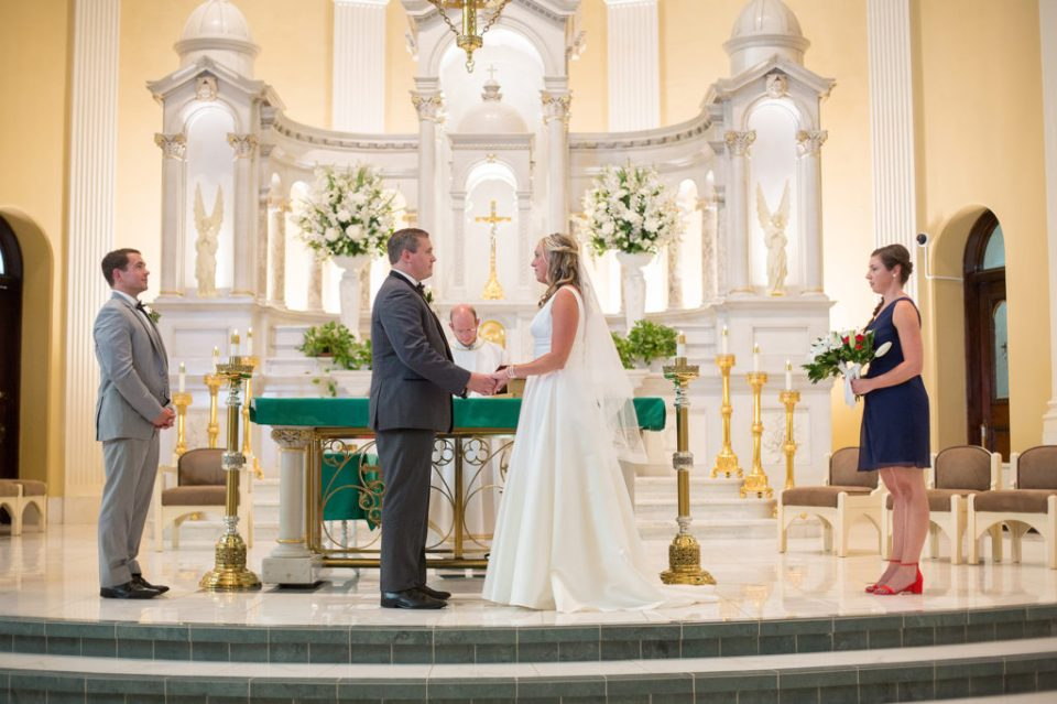 bride and groom stand at the altar during Saint Patrick's wedding