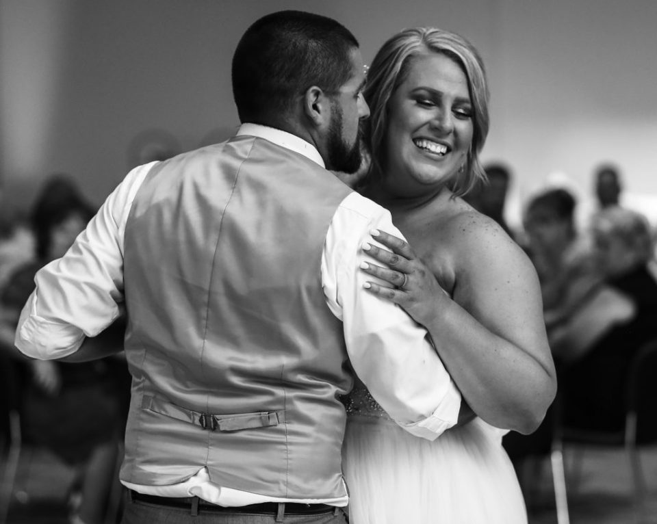 bride an groom share first dance together at Edinboro University wedding
