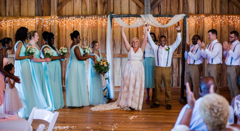 couple celebrate their marriage at the end of their Betsy's Barn wedding ceremony