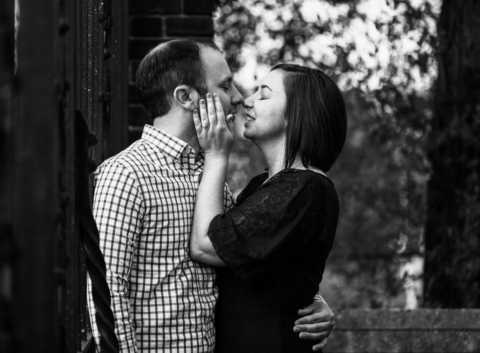 Engaged couple about to kiss during engagement photo session at Mellon Park in Pittsburgh PA