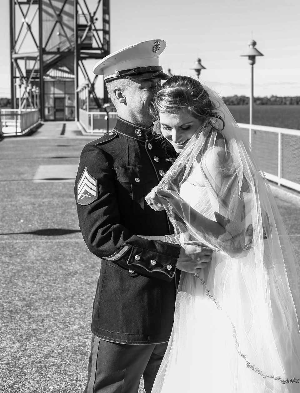 Bride and groom laughing in front of Bicentennial Tower in Erie PA