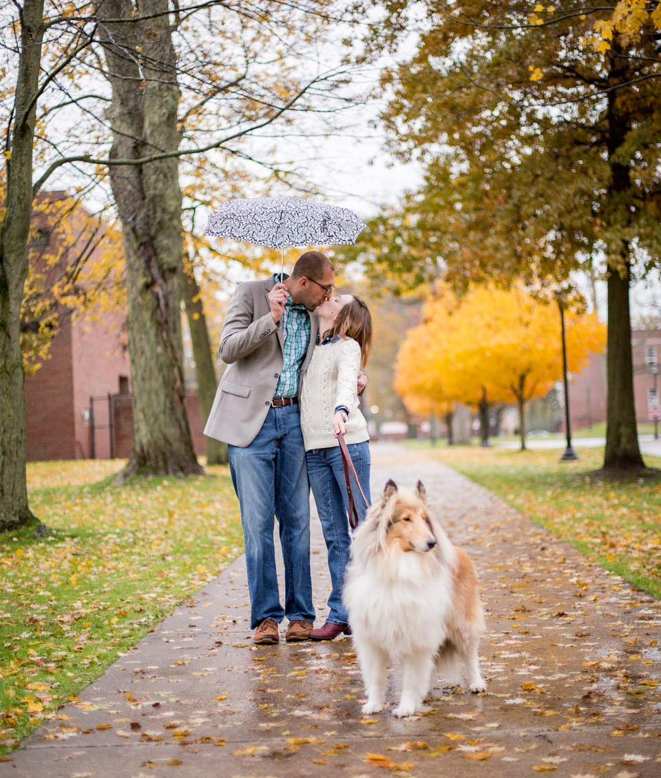Couple kisses under an umbrella in Edinboro PA engagement session