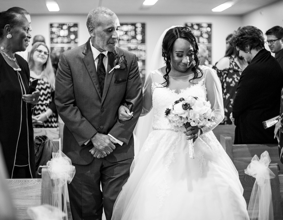 Father walks his daughter down the aisle during her Bellevue Christian Church wedding